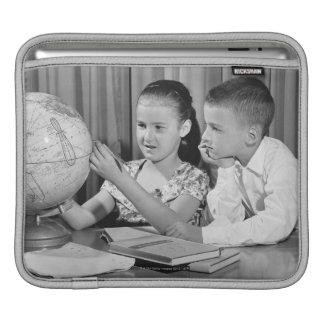 Boy and Girl Viewing Globe iPad Sleeve