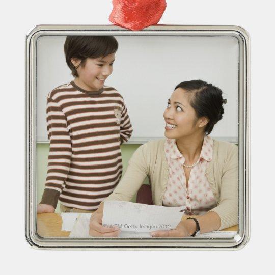 Boy and teacher at teachers desk metal ornament