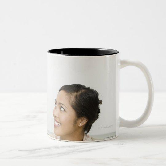 Boy and teacher at teachers desk Two-Tone coffee mug