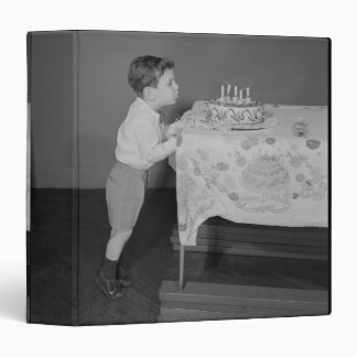 Boy Blowing Out Candles Binder