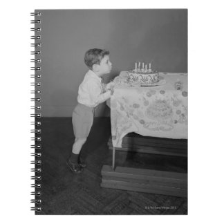 Boy Blowing Out Candles Spiral Notebook