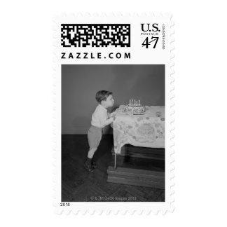 Boy Blowing Out Candles Stamp