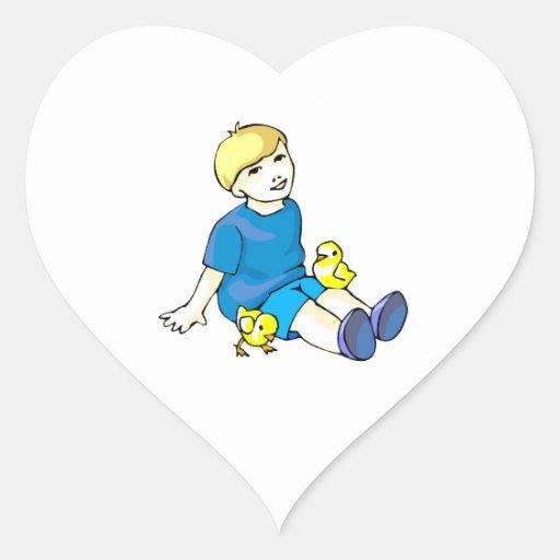 Boy blue shirt with yellow chicks heart sticker