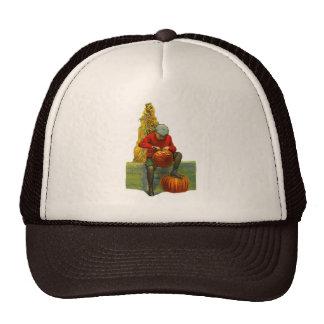 boy carving pumpkin trucker hats