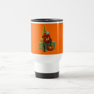 boy carving pumpkin travel mug