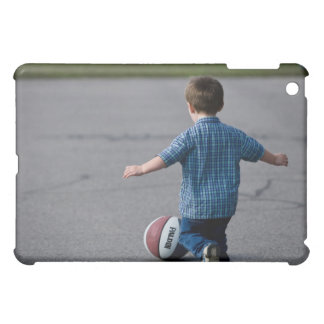 Boy chasing basketball outdoors case for the iPad mini