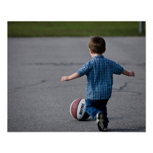 Boy chasing basketball outdoors print