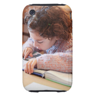 Boy concentrating on reading homework tough iPhone 3 cases
