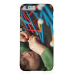 Boy connecting molecules for science project barely there iPhone 6 case