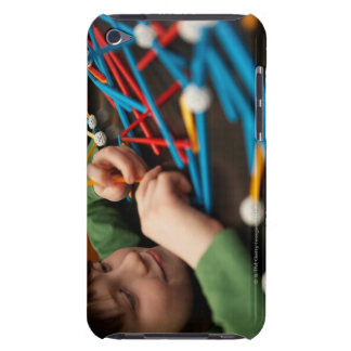 Boy connecting molecules for science project iPod touch case