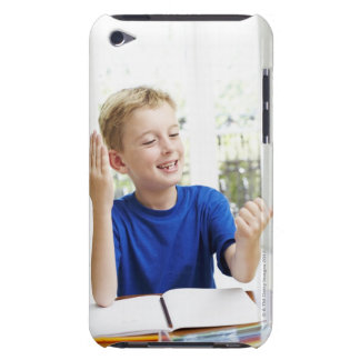 Boy counting on his fingers to complete his iPod touch case
