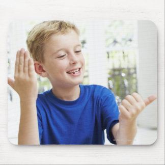 Boy counting on his fingers to complete his mouse pad