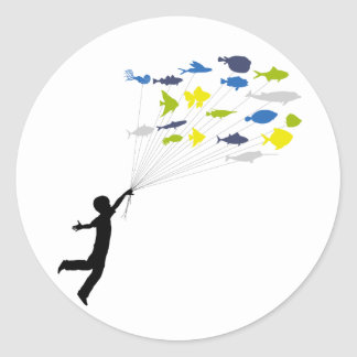 Boy Floating on Tropical Fish Balloons Classic Round Sticker