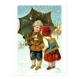 Boy, girl and umbrella postcard