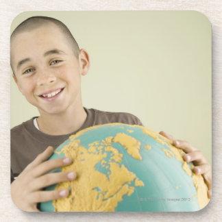 Boy holding globe drink coaster