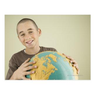 Boy holding globe postcard