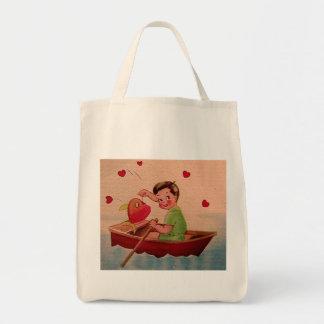 Boy Holding Heart in Boat Bags