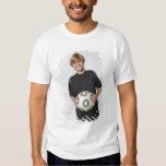 Boy holding soccer ball, smiling, portrait t-shirt