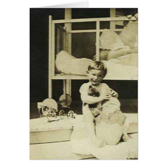Boy holding teddy bear card