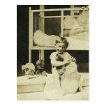 Boy holding teddy bear postcard
