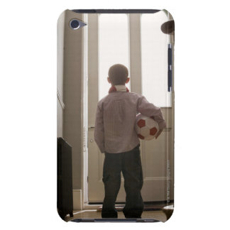 Boy in foyer with soccer ball barely there iPod cover