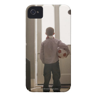 Boy in foyer with soccer ball iPhone 4 case