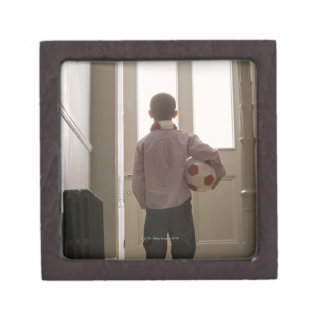 Boy in foyer with soccer ball premium jewelry boxes