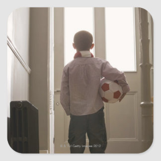 Boy in foyer with soccer ball square sticker