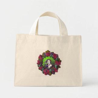 Boy in grape wreath, green grapes and purple mini tote bag