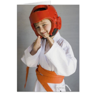 Boy in karate uniform wearing sparring headgear card