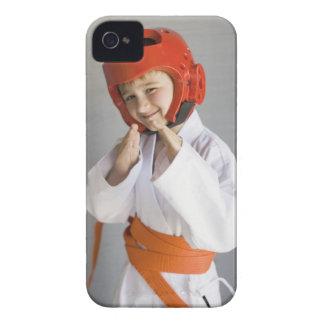 Boy in karate uniform wearing sparring headgear iPhone 4 cover