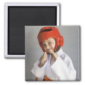 Boy in karate uniform wearing sparring headgear magnet
