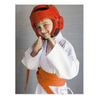 Boy in karate uniform wearing sparring headgear postcard