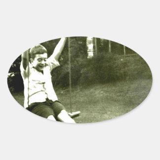 Boy In Swing Oval Sticker