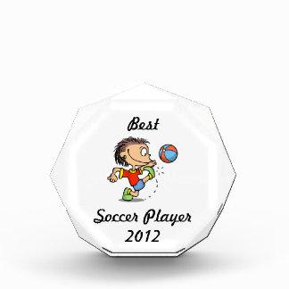 Boy kicking soccer ball Best Player Award