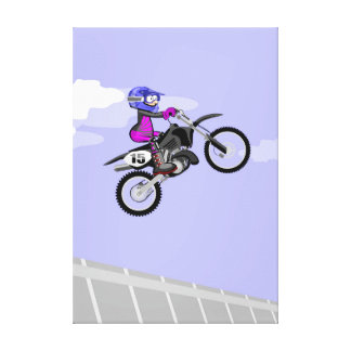 Boy makes a jump by the air in his motorcycle canvas print