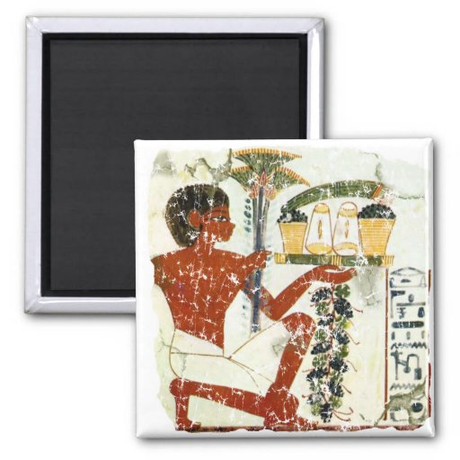 boy offering 2 inch square magnet