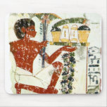 boy offering mouse pad