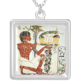 boy offering square pendant necklace