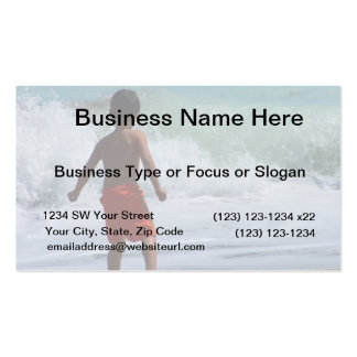 boy on beach playing in water business card