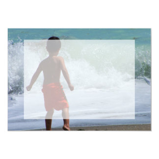 boy on beach playing in water card