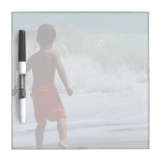 boy on beach playing in water dry erase board