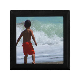 boy on beach playing in water jewelry boxes