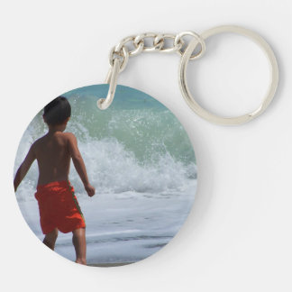 boy on beach playing in water keychain