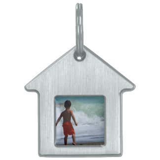 boy on beach playing in water pet name tag