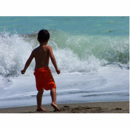 boy on beach playing in water photo sculptures