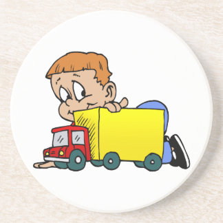 Boy playing with truck coaster