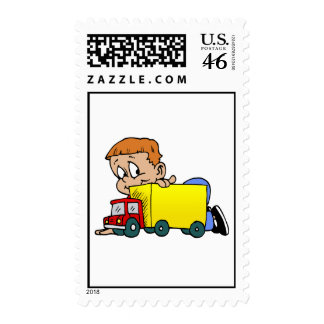Boy playing with truck postage stamps