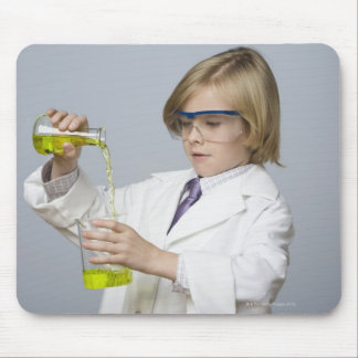 Boy pouring liquid into beaker mouse pad