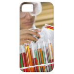 Boy pouring mixture from test tube iPhone 5 cases